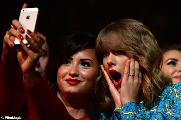 Getting it right: Demi Lovato and close pal Taylor Swift set up their selfie perfectly while enjoying their big night out