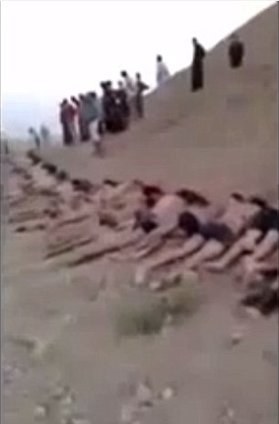 Horror: The video, too graphic to be published in full, fades to black before revealing a chain of men's bodies