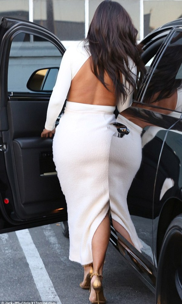 Peek-a-boo: Kim's tight top featured a cut-out on the back and sides, highlighting her tanned skin