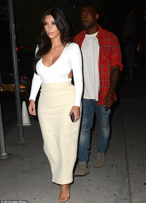 Lumberjack: Kanye was dressed down in jeans, a white T-shirt and red plaid shirt paired with grey suede boots