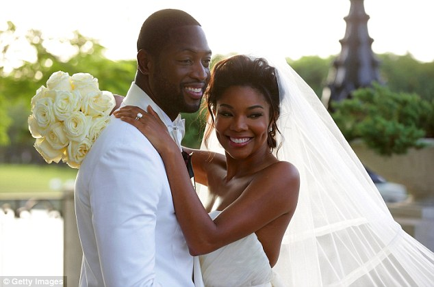 Introducing Mr and Mrs Wade: Gabrielle Union and Dwyane Wade exchanged vows in a luxurious and extravagant ceremony at Chateau Artisan in Miami on Saturday, the bride and groom looking simply stunning in their matching white ensembles in the first official photo