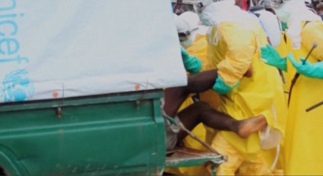 By any means necessary: With locals panicking at the thought of a highly contagious Ebola patient on the loose, the health workers use force to bundle him into the UNICEF vehicle