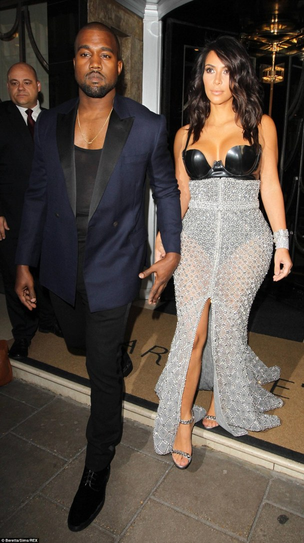 His leading lady: The reality star was accompanied by her husband, rapper Kanye West. The pair kept a firm hold of one another as they left their hotel