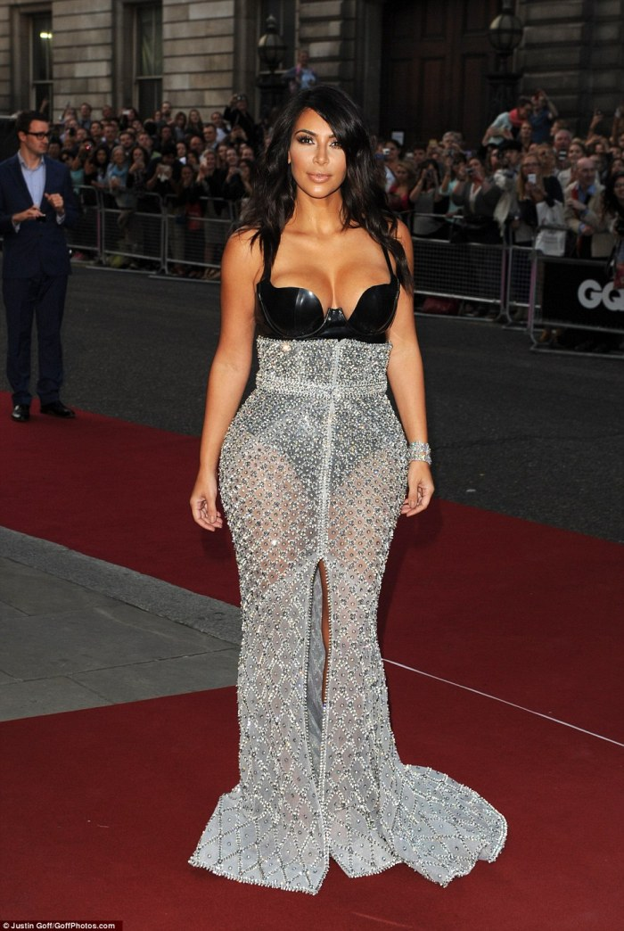 Daring! Kim Kardashian showed off her incredible figure in hate couture custome-made gown by Ralph & Russo at the GQ Men Of The Year Awards on Tuesday