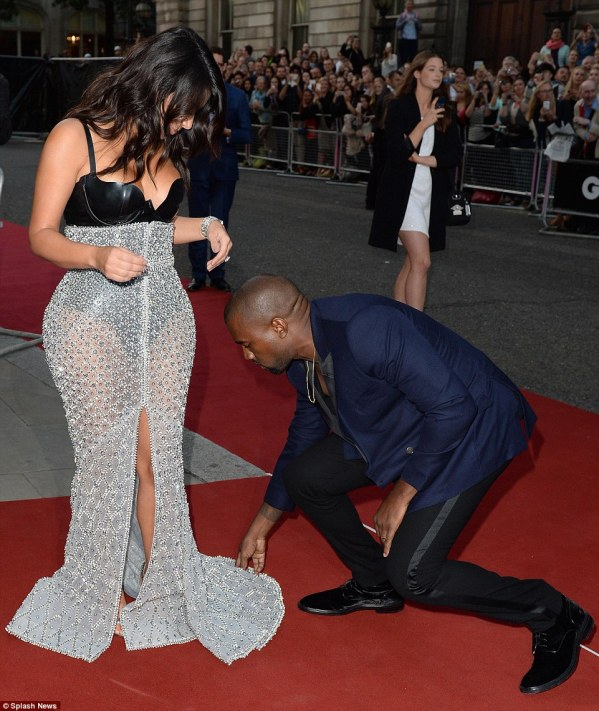 What a gentleman: Kanye, 37, assisted Kim as she walked the red carpet and made sure she didn't trip up on her heavy gown