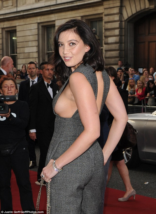 Daring: The model made the most of her assets when she let the side angle do all the talking on the red carpet