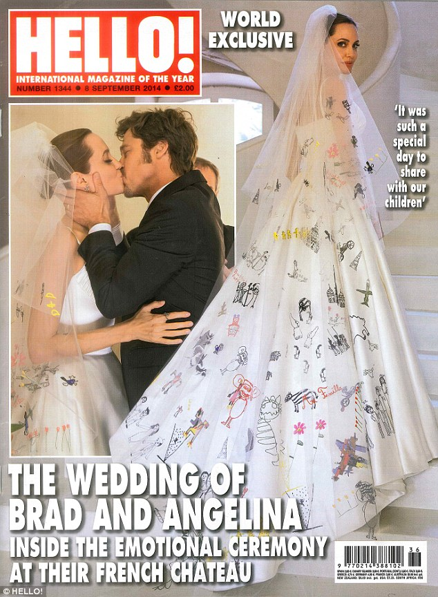 Introducing Mr and Mrs Pitt: Brad Pitt and his new bride Angelina Jolie shared a passionate kiss on the cover of HELLO! magazine which along with People obtained the exclusive rights to their wedding in France