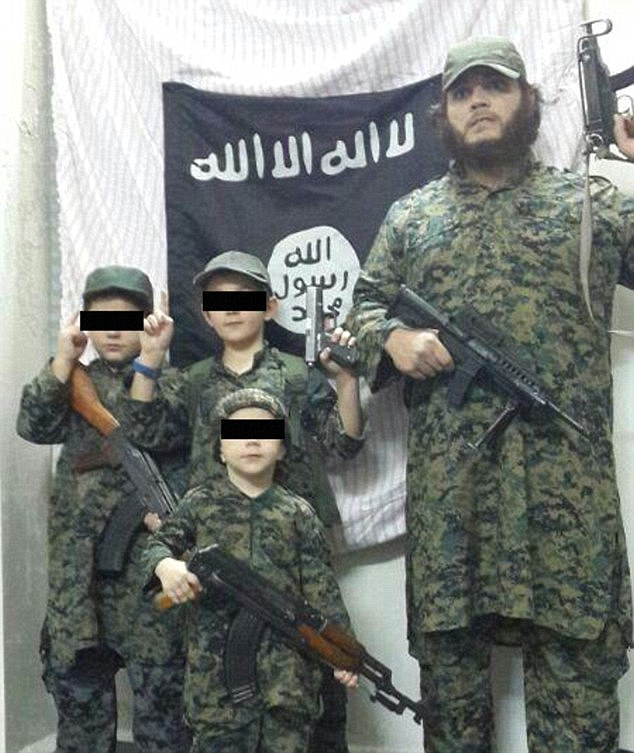 Khaled Sharrouf with his gun-wielding sons:ISIS has made it a policy to groom children to take part in jihad, brainwashing them from a young age