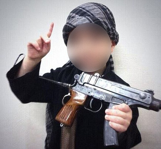 Another image spread online by the group shows a  boy barely school age clutching an automatic rifle