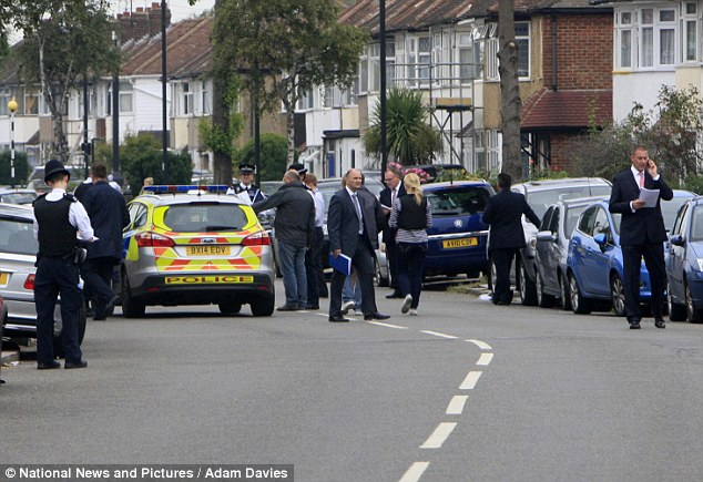 Police attend the scene in Nightingale Road after a woman was found dead in a garden