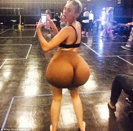Look familiar? Miley Cyrus, 21, did her famous tongue out pose as she shared an Instagram snap with a rather massive derriére Photoshopped on her body late Wednesday