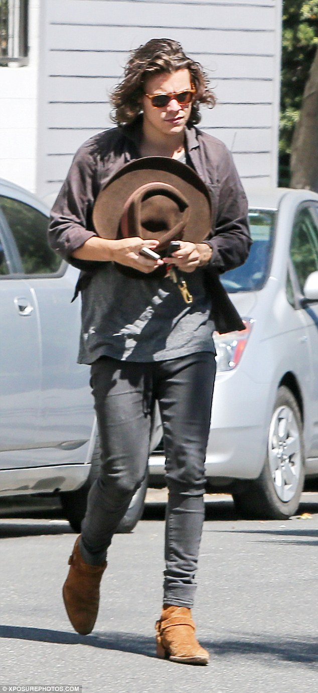 styles shows off long hair in la before where we are tour resumes