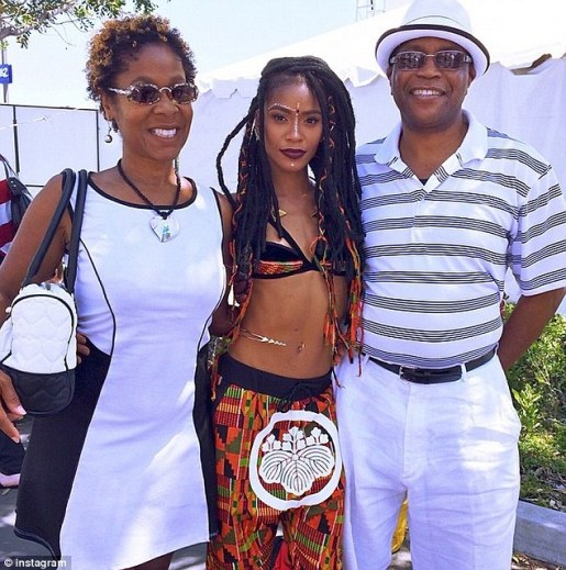Family: Battle (center) pictured with her mother Donna Morgan (left) and father Anthony Battle (right) at Wango Tango is Los Angeles this past May