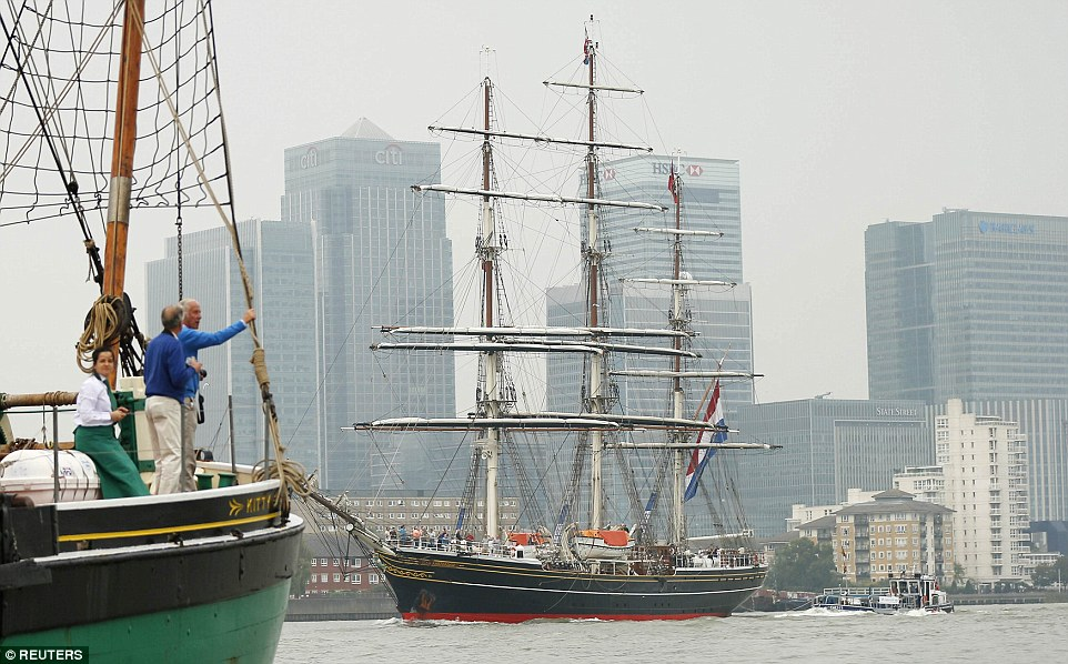 The Tall Ship Stad Amsterdam is pictured sailing past Canary Wharf on the River Thames. Twenty tall ships which will be moored at Wood Wharf in Canary Wharf