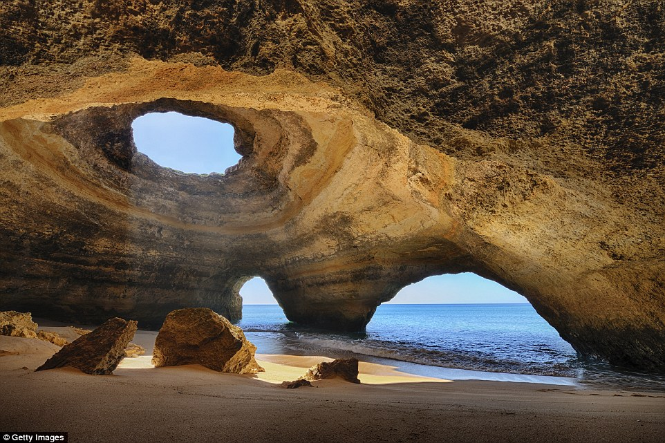 Paradise: The stunning Algarve caves in Portugal are a popular destination for curious tourists, who can also spot dolphins in the waters nearby