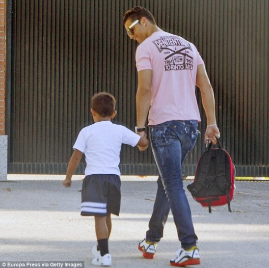Doting dad: Footballer Cristiano Ronaldo brought his adorable four-year-old son Cristiano Ronaldo Jr. to school in Madrid, Spain bright and early on Monday morning