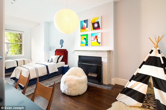 Stylish fun: Currently The Sex And The City actress has styled one of the five bedrooms for Marion and Tabitha, 5 , to share and it has a sitting area, fireplace and an adorable white and black striped teepee for the girls to play forts