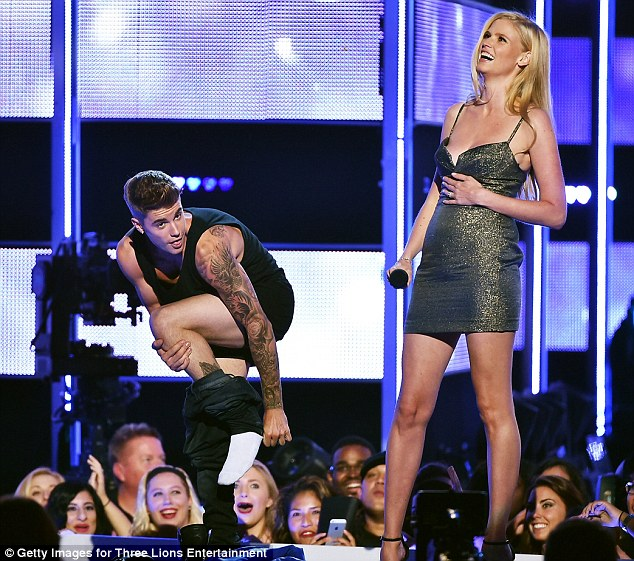 Strong reaction: Lara laughed and the crowd was surprised to see Justin strip