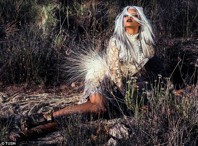 Desert bunny: The Bajan star wore a white outfit as she reclined in some scrub