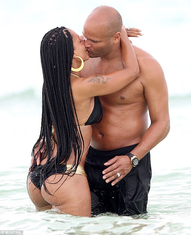 Heating things up: The former Spice Girl sported long braids as she took a dip in the crystal clear waters and made out with husband Stephen Belafonte
