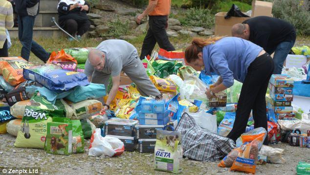 Generous: Volunteers sort through piles of dry and tinned dog food | ozara gossip