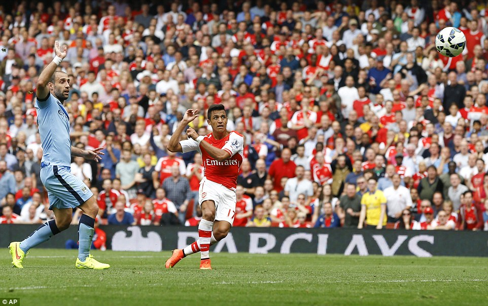 Alexis Sanchez shoots on the volley to beat Manchester City keeper Joe Hart and give Arsenal the lead at the Emirates Stadium