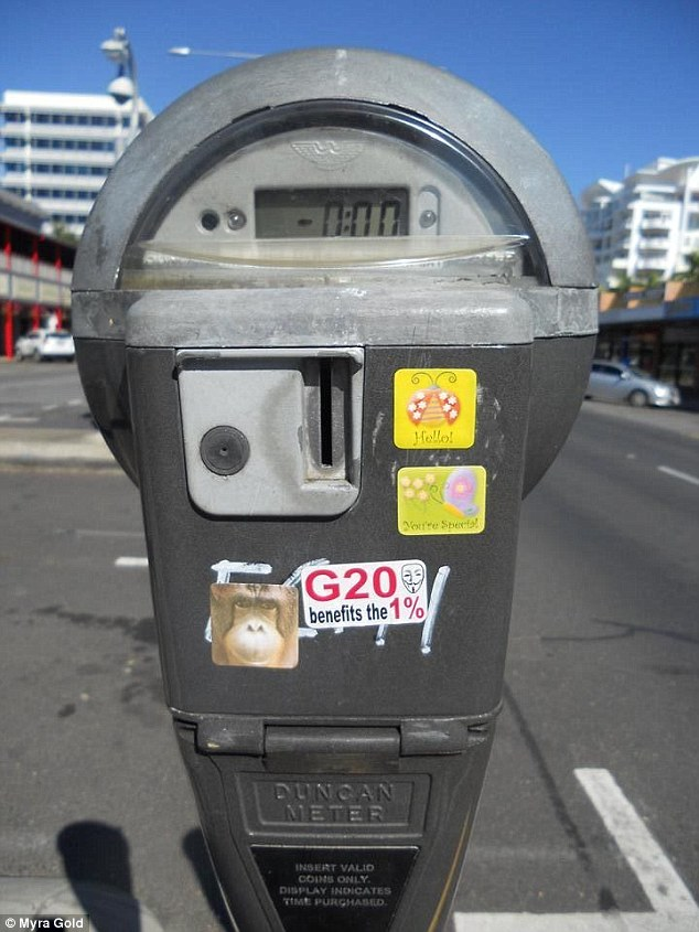 Ms Gold is accused of placing a tiny sticker, similar to this one, on a pole near Raintree Shopping Centre in Cairns.