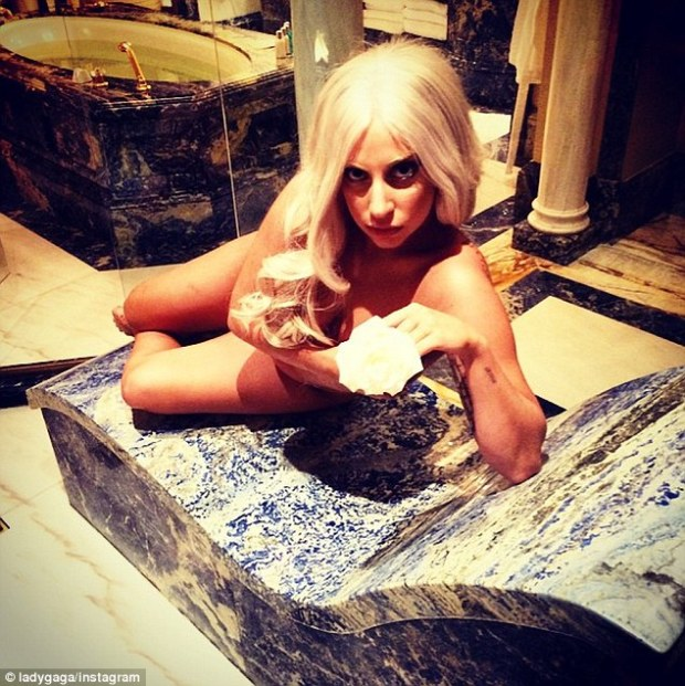 'The Royal Suite fit for a Goddess!' The 28-year-old pop diva wore nothing aside from a sparkly pink thong while reclining on a blue marble shower bench