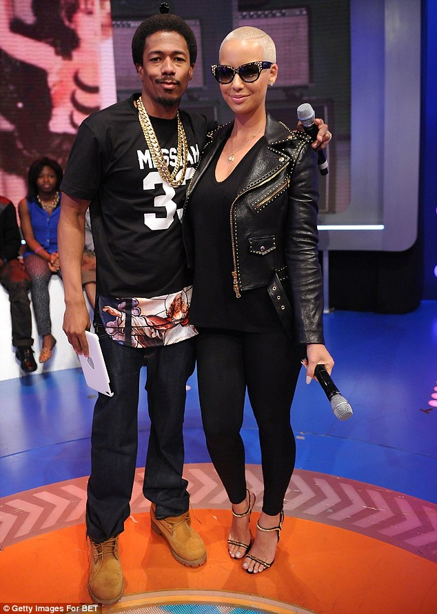Business partners? Nick Cannon allegedly has signed Amber Rose to his management company NCredible Entertainment, pictured together in NY in July