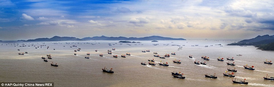 Fishing boats head out to sea in Ningbo, Zhejiang Province, China after the summer fishing suspension ends