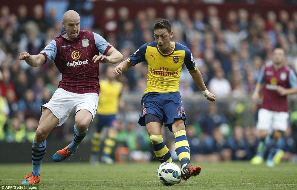 Mesut Ozil evades Philippe Senderos to latch on to Danny Welbeck's pass and score Arsenal's opening goal against Aston Villa