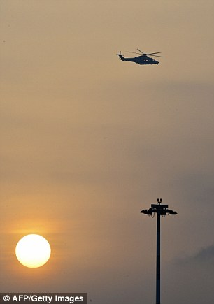 The helicopter which took the Pope from the Vatican to Rome's international airport is pictured in flight