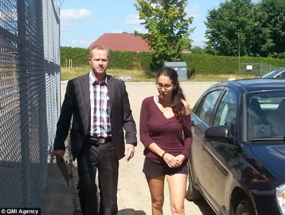 Beaudoin(right) pictured in August with her lawyer Denis Lavigne. She is due back in court on November 17