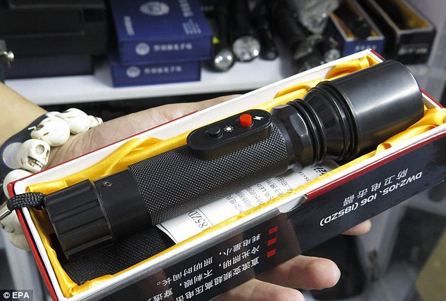 Amnesty International said while most of the tools are legitimate, many are inherently cruel and inhumane. Pictured is a flashlight that also functions as an electric shock device
