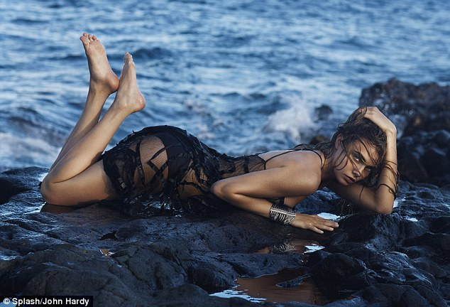 Making waves: The London It-girl looked every inch the supermodel as she sported a sheer black dress on the rugged coastline