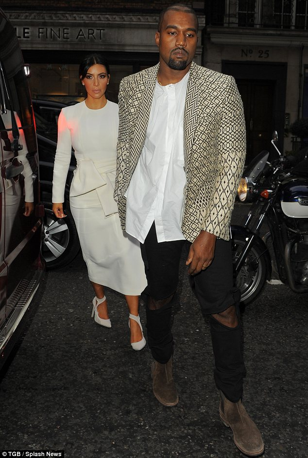 Leading the way: Kanye led his wife, who he married in Italy in May, by the hand as they enjoyed a dinner date at Hakkasan in London