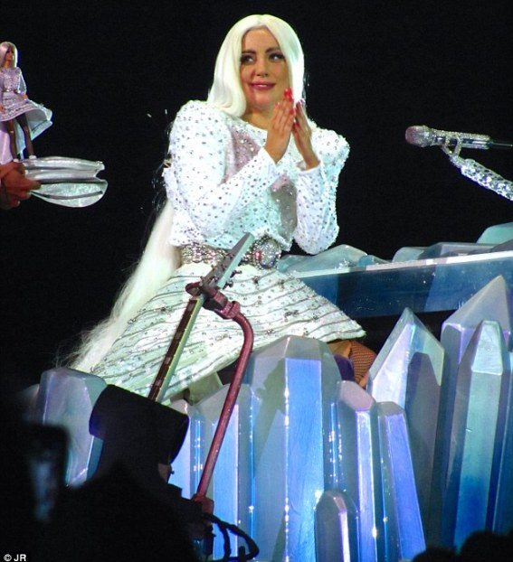 Bit of all white: The singer also had a more mature white embellished number for the show, along with a white wig