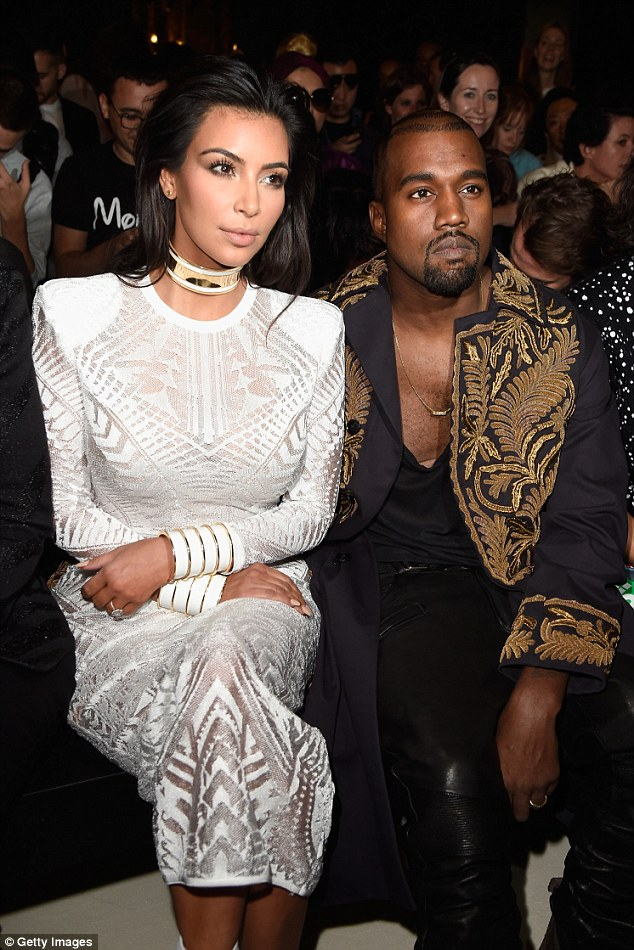 Front and centre: Kim Kardashian and Kanye West both turned heads in their outfits as they sat front row