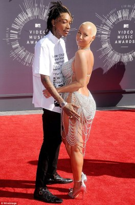 Sudden split: Amber filed for divorce from Wiz on Tuesday after 14 months of marriage. They are pictured here last month