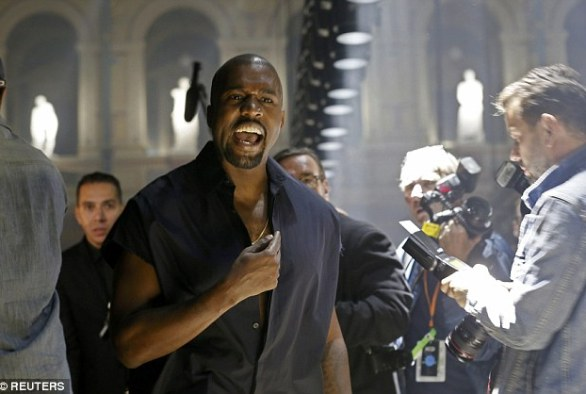Defensive: Kanye West tells high-fashion hecklers to stop booing at the Lanvin show at Paris Fashion Week