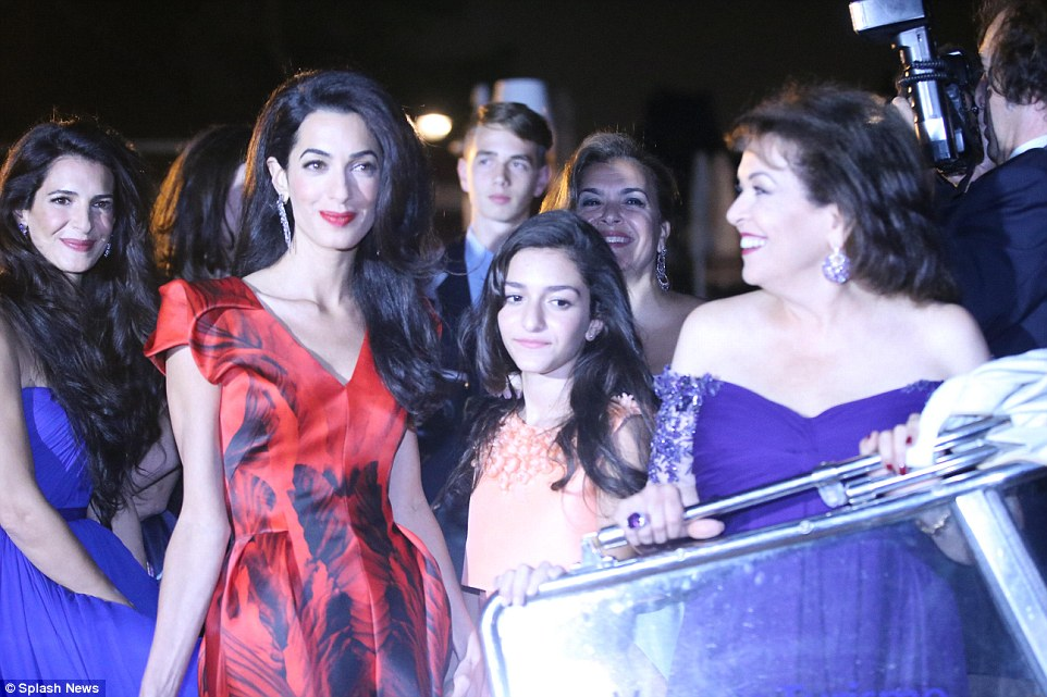 Radiant: Amal positively glowed with happiness while surrounded by her family