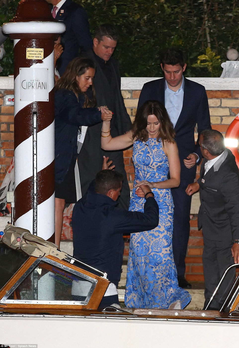 Star-studded: Emily Blunt - who is joined by her husband John Krasinski - gets a helping hand as she climbed onto the boat