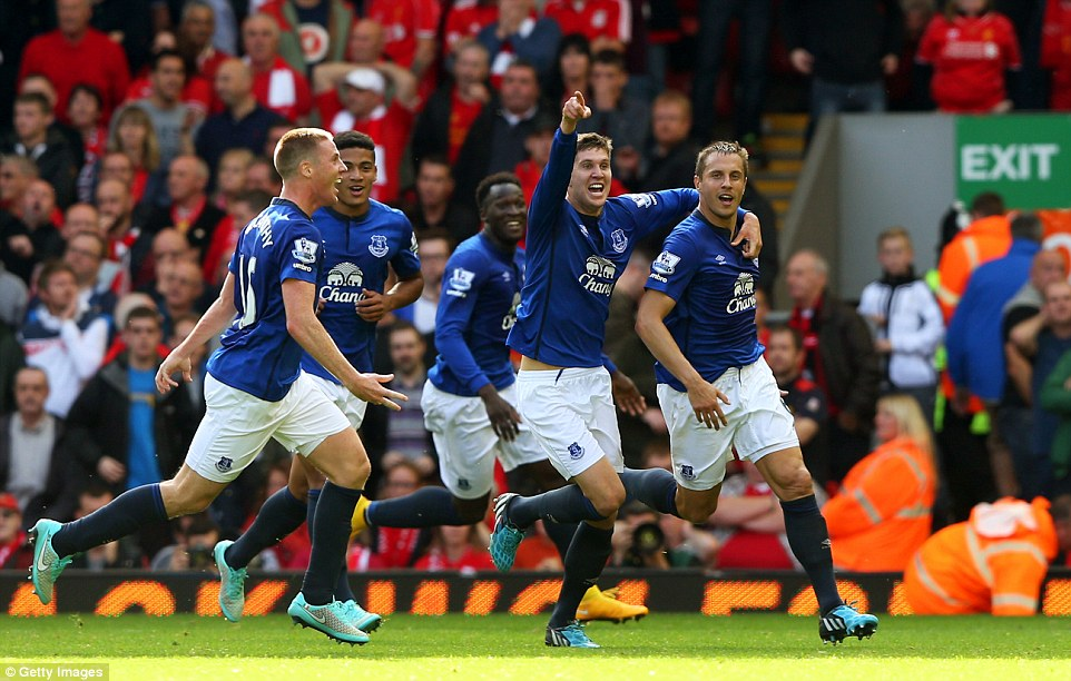Everton celebrate the injury time equaliser from Phil Jagielka (right) after his stunning half-volley clinched a draw in the Merseyside derby