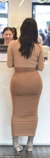 Bum note: Kim was said to be shaken after a crazed fan almost knocked her over during Paris Fashion Week