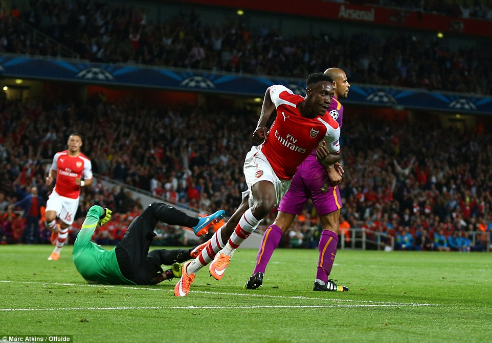 Welbeck turns to run away in celebration as the Galatasaray goalkeeper lies on the floor having conceded the first goal of the night at the Emirates Stadium