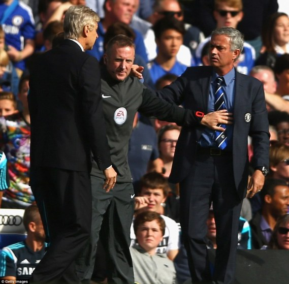 It only took 20 minutes for the two managers, who have a long-running feud, to come to blows during the first half of the league clash