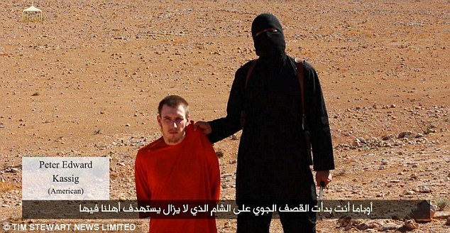 Threats: American ISIS hostage Abdul-Rahman Kassig, 26, who was known as Peter Kassig before he converted to Islam in captivity. He is pictured with Jihadi John, who threatens to behead him in a video for the terror group.