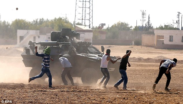 Clashes: Military police battle with Kurdish demonstrators during an anti-Islamic State protest | ozara gossip