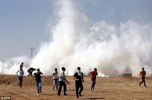 Tear gas: The anti-Islamic State protests took place near Sanliurfa in southern Turkey - ozara gossip