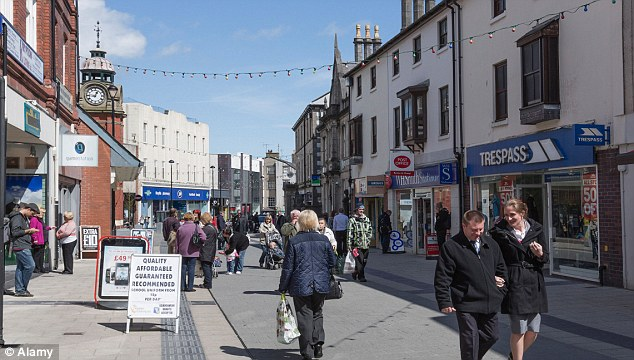 Shift: Also up were gyms, fish and chip shops and betting shops. Pictured: Bangor High Street in north Wales